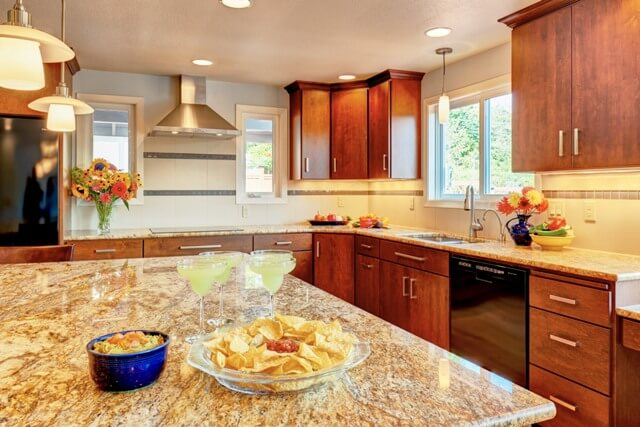 This Corvallis kitchen features custom maple cabinets and granite counters.
