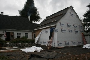 Tyvek housewrap being installed on the mater suite addition.  Hardiboard lap siding shakes will go over the housewrap.