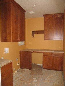 Rustic Cherry cabinets in laundry room