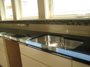 Uba Tuba granite countertops with tile splash