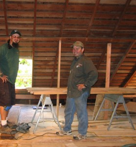 Ted and Dean take a moment to admire their new floor sheeting