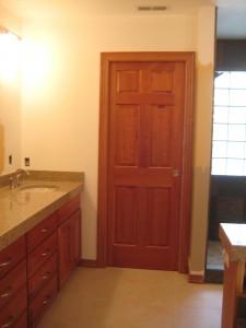 Bathroom door stained to match.