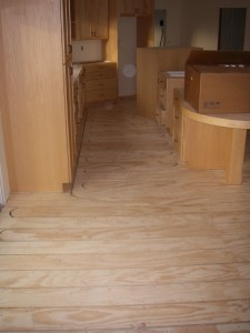 Plywood subfloor with tubing for flooring heat