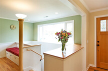 Finishing touches in this eco-friendly renovation include a custom newel lamp post, hand crafted trim.