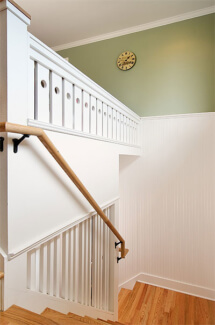 Custom built stairs all in white with dye cut pickets.