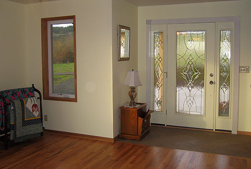 This living room addition moved the front entry to a new location.
