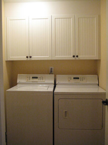 The laundry in this basement remodel is concealed behind bifold doors.