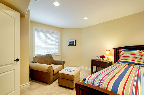 The cozy bedroom with a seating area.