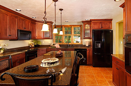 The new kitchen design includes a large window to add natural light and visually expand the space.