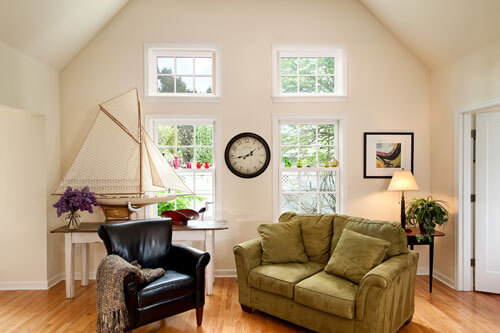 This sitting room has a vaulted ceiling and a nautical theme with a schooner.