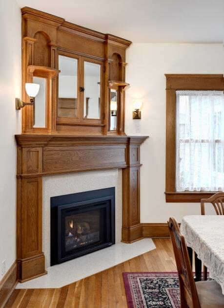 White oak mantel surround to match upper cabinet.