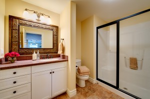 A large framed mirror helps give this bathroom an updated look without breaking the bank.