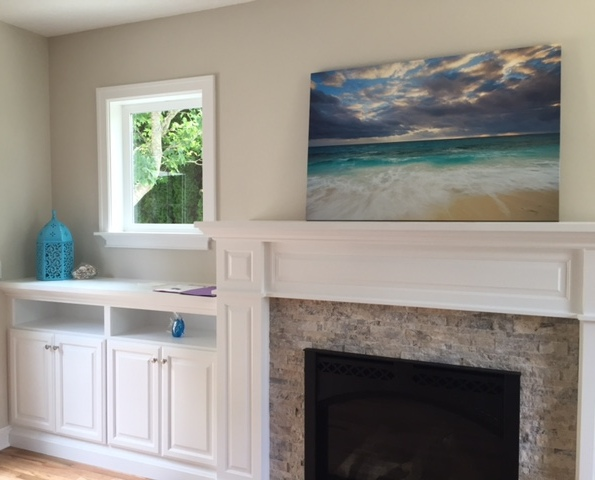 Travertine fireplace surround and white painted mantle