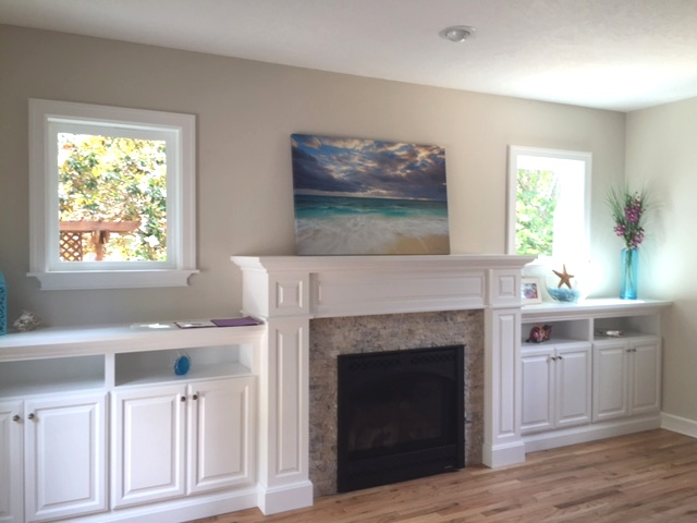 Built-in fireplace cabinetry for Heat n Glo fireplace and travertine surround