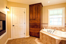 This extensive renovation converted three small bedrooms into a spacious master bath with see-through fireplace.