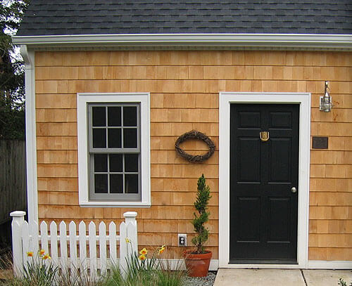 Alaskan yellow cedar siding on a Cape Cod garage
