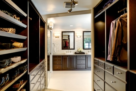 The dark cabinets in the walk-in closet coordinate with the bathroom vanity.