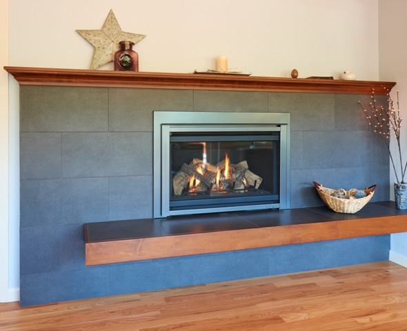 Gas fireplace with maple mantle to match kitchen