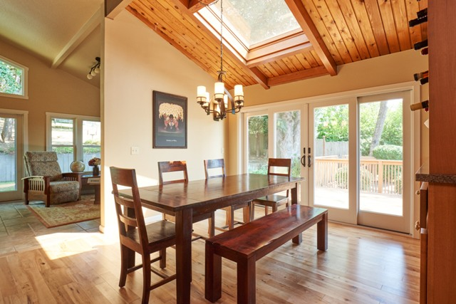 Andersen wood windows, skylights and wood paneled ceiling give home lodge style