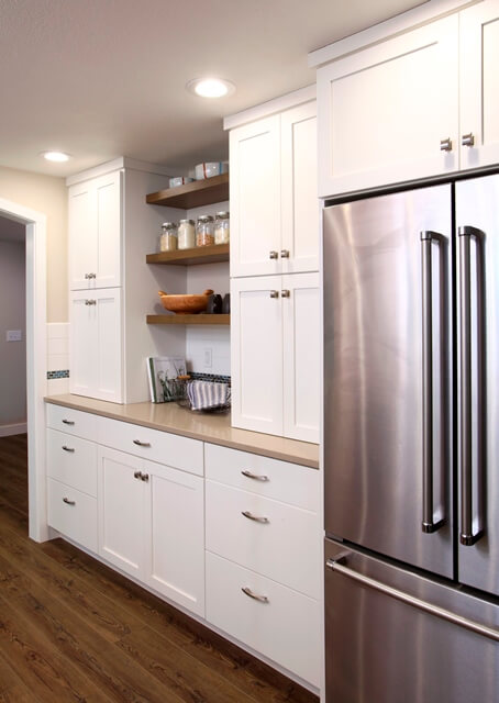 The redesigned contemporary kitchen combines open shelves and enclosed storage.