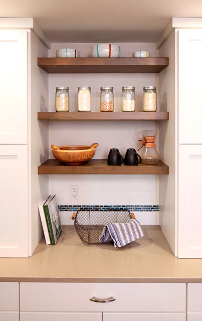 Open shelves create an airy contemporary feel in this kitchen remodel.