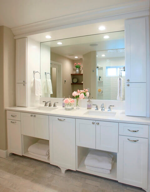 The vanity provides ample storage and has a unique feature of under-sink towel storage.