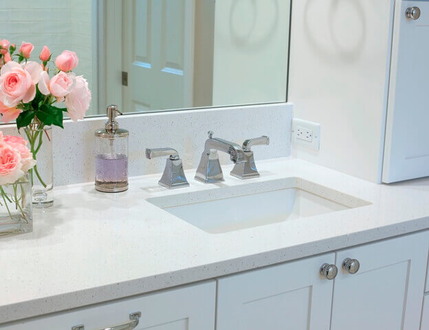 "This bathroom remodel features an undermount sink with PentalQuartz ""Crystal White"" countertops."