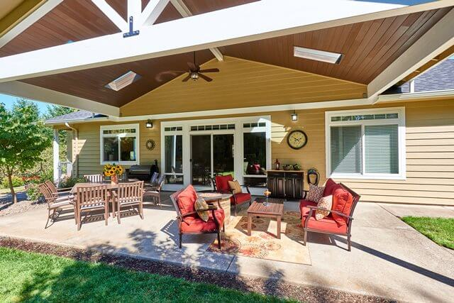 A covered patio creates an outdoor space for barbecues.