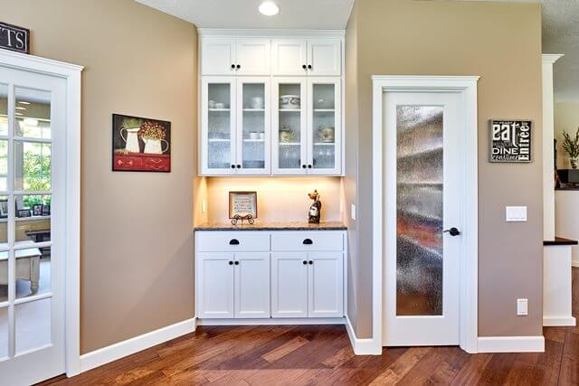A pantry and built-in dining buffet provide additional storage.