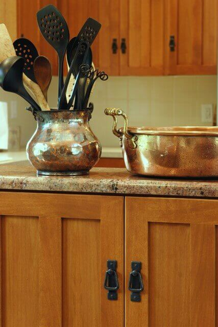 Granite countertops with shaker style cabinets.