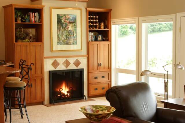 The great room features a new gas fireplace and built-in cabinetry.