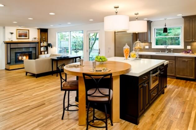 This contemporary kitchen includes seating for guests as a custom designed table can be pulled out when entertaining.