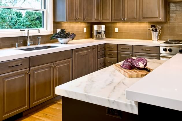 Distinct work stations for multiple cooks include this marble counter for pastry.