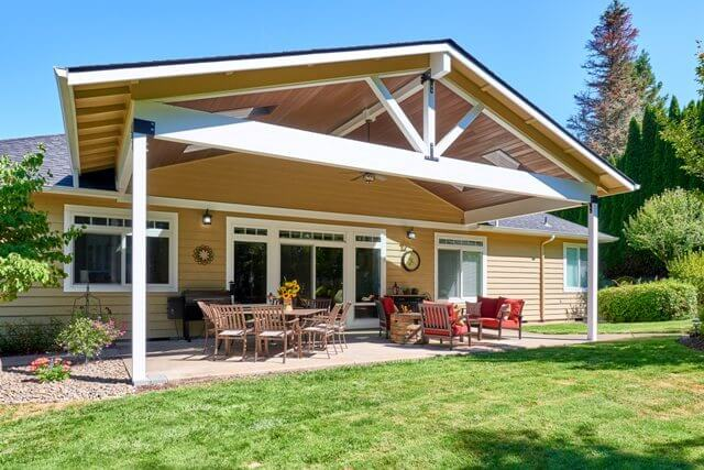 Under the new porch roof, outdoor dining, grilling, and seating are accommodated.