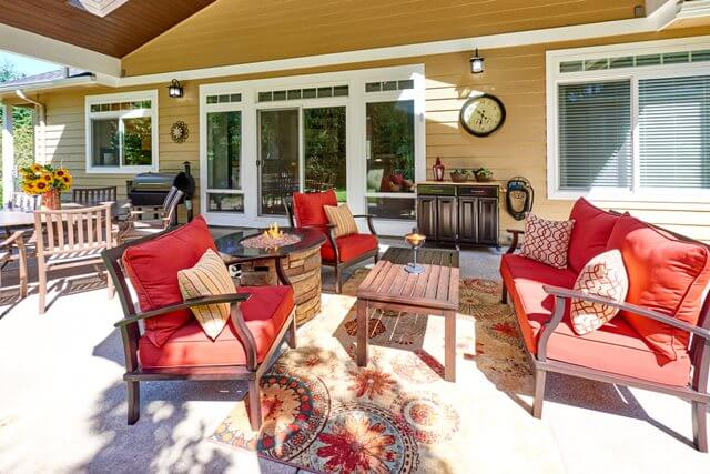A covered patio creates an outdoor living room.