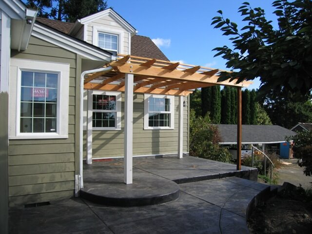 An existing patio roof was incorporated into the design to enlarge a bedroom and add a private bathroom.