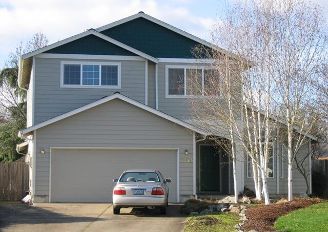 Over-the-garage addition in Corvallis looks as though it is part of the original home.