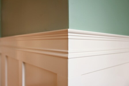This small bathroom remodel includes hand-crafted wainscoting to give height to the small space.