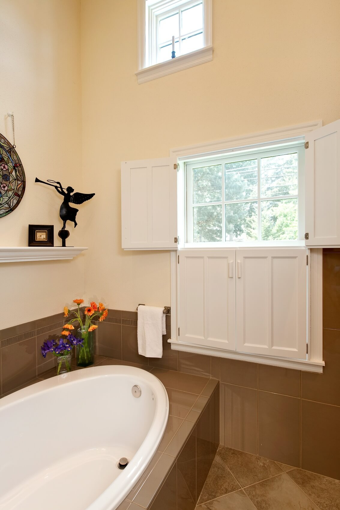 The bathroom features an extra deep soaking tub room. The shuttered window provides charm and privacy.