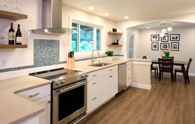 This redesigned white contemporary kitchen acts as the central hub of the home.