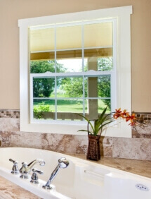 The spa-like master bath includes a jetted tub.