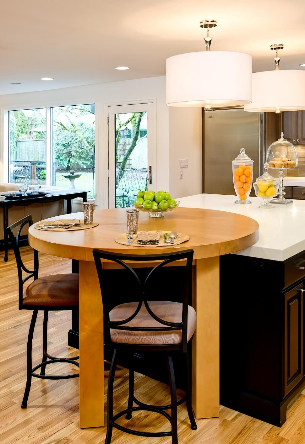 An inventive custom table in the remodeled kitchen can rest on the counter or stand freely.