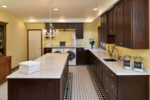 A large laundry room island with Silestone counters.