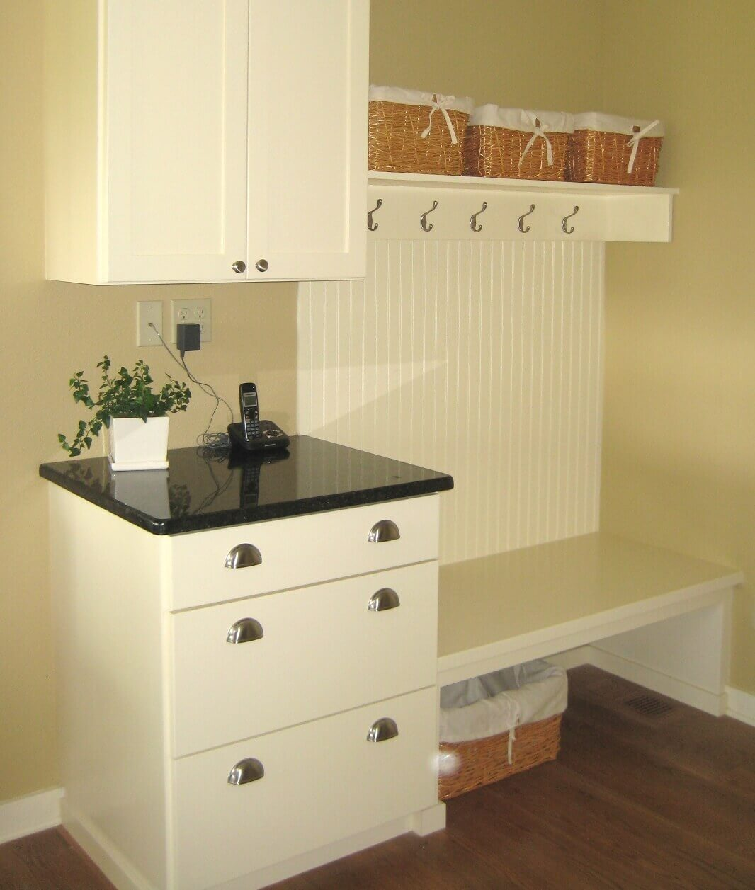 An informal side entry serves as a message center with drawers, baskets, hooks, and shelves to keep things organized.