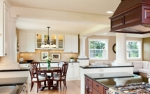 The great room design integrates the kitchen, dining, and family rooms.