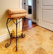 Tile is shown on the bathroom floor and Wilsonart maple laminate flooring for the hallway.