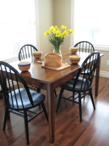 The dining area is adjacent to the kitchen.