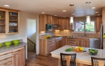 Quarter-sawn hickory cabinet doors expand on the rustic theme in this kitchen remodel.