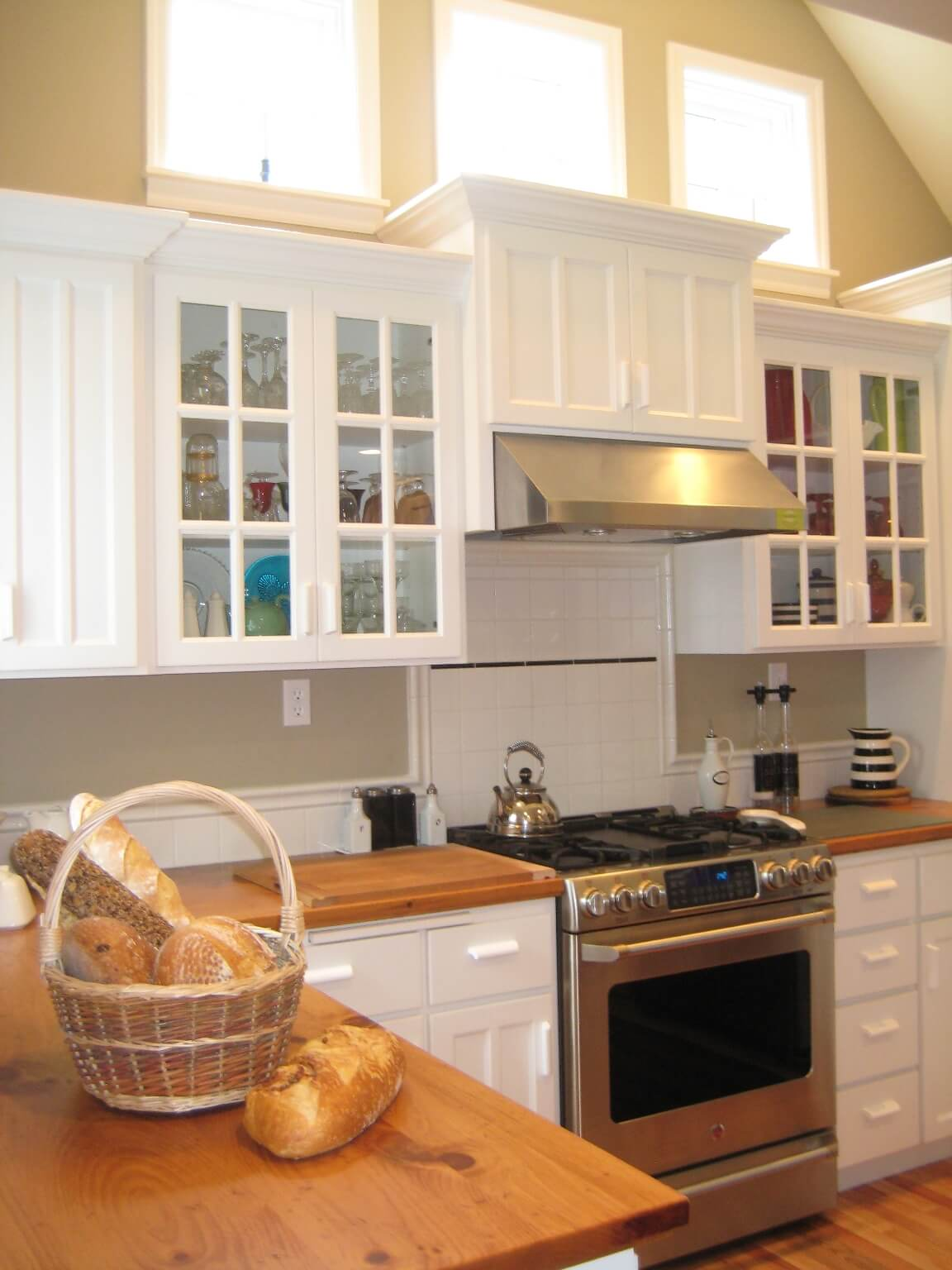 Simple door and pull styles and painted cabinets match the Cape Cod charm of the rest of the home.