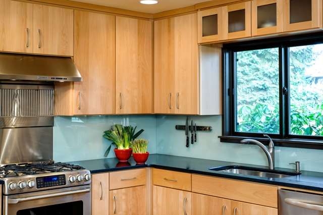 The remodeled kitchen features sleek beech cabinets and Caeserstone counters.